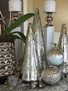 This white and silver metallic theme is gorgeous for the holidays. I love these mercury glass trees from HomeGoods! Add a little  fake snow to your vignette for some whimsy and texture. { sponsored }
