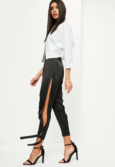 Be a self-proclaimed babe in these satin trousers - featuring a high shine finish, split sides and tie detailing on the ankle for an extra chic finish.