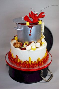 """Made this cake for a friend's 40th birthday party. We were having a crawfish boil and the birthday boy is a professional weightlifter, so I made a crawfish with a dumbbell made from fondant """"corn"""". Everything is edible except the cast iron pot..."""