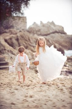 These kids are just too cute! Love the ring bearer's outfit. what im looking at for my ring bearer but with coral suspenders!!