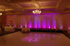 White Backdrop with LED up lighting and monogram gobo
