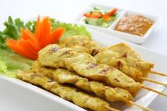 Thai Chicken Satay - tasty recipe for this popular appetizer including peanut sauce and cucumber relish. Temple of Thai recipes.