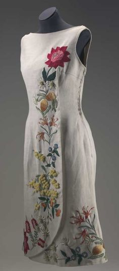 1964 Beige linen sleeveless dress with Australian wildflowers embroidered down the front and around the hemline.