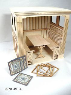 1:12 Scale Museum quality furniture by JBM Miniatures.  Designed by John Baker, an English cabinet maker by trade who now brings his passion for design and quality finishes to miniature furniture.