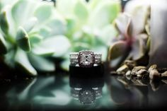 This is probably my favorite ring shot that I've ever done. I just love how it looks like it's in a terrarium.  Want to know how I did it? Hint: It wasn't in a terrarium  The couple had succulents as favors so I grabbed a few & tipped them on their sides and let some of the dirt & rocks fall out. Then I put my video light on top of it...and voila!  When the wedding coordinator saw me doing it he did give me a little bit of a hard time because he had just spent the time setting up all of the…
