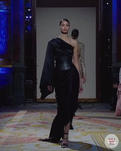 Black One Shoulder Evening Maxi Dress / Evening Gown with One Long Sleeve and a small Train. Fall Winter 2020 / 2021 Ready-to-Wear Collection. Runway Show by Redemption.
