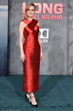Playing with fire! Brie Larson sizzled in a stylish ruby red halter gown at the premiere of her upcoming action film, Kong: Skull Island, in Los Angeles on Wednesday
