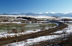 Winter view of railroad in Liptov region, Slovakia. Snow covered Low Tatra Mountains can be seen in distance.