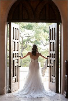 Bridal portraits in entrance of chapel. Lost Mission, Spring Branch TX