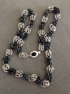 "Sweet pea necklace 20"" long in BA & iridescent gunmetal AA with silver & onyx clasp"