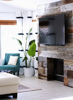 I'm sure there are many homeowners out there who will appreciate this feature showing ideas on how to clad a fireplace with reclaimed woo...