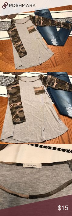 ⭐️5 FOR 40 / 3 FOR 30⭐️ Cammo Pocket Long Sleeve *RePosh* 12PM by Mon Ami Cammo Pocket Long Sleeve Tee in Size Small. Heather grey with sleeves and front pocket with camo print. Super soft and comfortable! Create a bundle and send me an offer! 12 Pm By Mon Ami Tops Tees - Long Sleeve