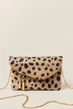 The Andrea Mini Angled Leopard Crossbody Clutch features a soft faux leopard exterior and gold hardware in the perfect date night size! Crossbody Clutch, Clutch Purse, Purse Wallet, Leopard Clutch, Fashion Bags, Handbags, Purses, Collection, My Style