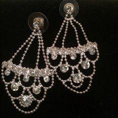 Silver & Rhinestone Earrings Silver and rhinestone earrings. Scalloped design. Pierced ears. Two inch drop Jewelry Earrings