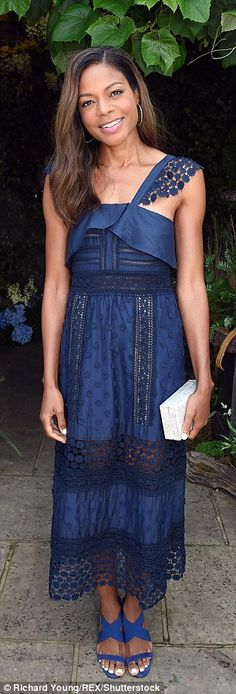 The 39-year-old former Miss Moneypenny looked glowing in a blue floor-length dress with sh...