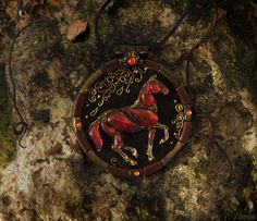 Equestrian jewelry. Necklace with red horse