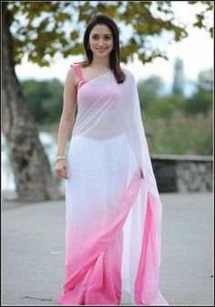 Tamanna Bhatia images in a White saree are clicked from 'Oosaravelli' movie. Tamanna looks like an angel in the white & pink colour saree. South Indian Actress Photo, Indian Actress Photos, Indian Actresses, Beautiful Girl Indian, Most Beautiful Indian Actress, Beautiful Saree, Organizer Box, Saree Photoshoot, Stylish Sarees
