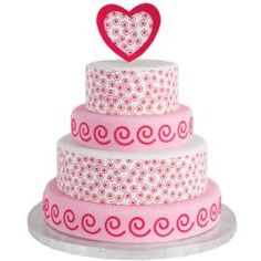 A treat for the heart and soul, this four-tiered cake is meant to impress. Use swirl-patterned Sugar Sheets! and punch inserts to festoon every layer with freewheeling forms.