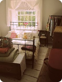 this is perfect, love every bit here, from the whites to the vintagey pillows to the vintage suitcase.
