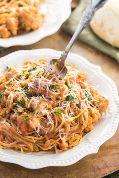 Thin Spaghetti tossed in a thick tomato gravy sauce with white wine and chicken. A quick & easy meal that kids and adults all love to eat!