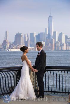 Alena and Mike with a view of Manhattan.  #manhattan #newyorkcity #nyc #bride #groom #justmarried #happycouple #anthonyziccardistudios #aziccardi