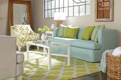 Bright, cheery room with blue and green tones set with a Surya Frontier rug and @Rowe Furniture