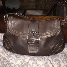 Leather medium/ large shoulder bag Brown leather with front buckle and back pocket area Coach Bags Shoulder Bags