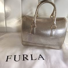Furla Gold Glitter Candy Bag Gorgeous and Complete Furla Gold glitter Candy Bag with lock, dust bag and hang tag. Perfect condition, I carried it only twice to holiday parties. Purchased direct from Furla online. I am cleaning out my closet in anticipation of a move and I just can't keep everything! Furla Bags Satchels