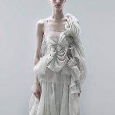 Pleats, fabric treatment, fabric manipulation, couture details, gathering, layering, draping.  Yiqing Yin