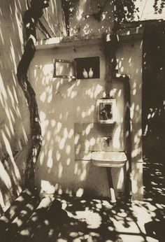 """Self-portrait in a courtyard of Baku"". (Pinkhassov's reflection). Baku, Azerbaijan, Soviet Union. 1976.  © Gueorgui Pinkhassov / Magnum Photos"