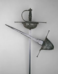 Blade: Italian  Hilt: Spanish    Cup-Hilt Rapier in the Spanish Manner, 1650/60    Steel, iron, wood  L. 127 cm (50 in.)  Blade L. 108.5 cm (42 3/4 in.)  Wt. 2 lb. 11 oz.