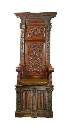 A High-backed walnut joined box chair, dated 1537, with linen fold panels.