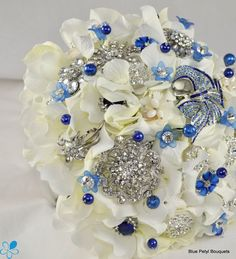 Sapphire Hydrangea Brooch Bouquet #bridal #bouquet   I would add Aquamarine in here too.