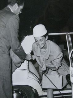 Audrey Hepburn photographed with Mel Ferrer during their arrival at the Hotel Hassler in Rome, on March 25, 1961.
