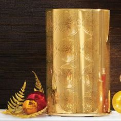 "#Johnathan Adler for #PartyLite #Santorini Hurricane P91662 $90.00 Golden-finished glass hurricane with Jonathan's signature starburst pattern radiates glamour all around. Includes a gold-tone, three-tealight stand. Add a pillar candle or jar candle, sold separately, for fabulous shimmer. Metal base. 9½""h, 5¾""dia."