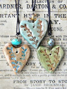 forest heart necklaces by delila @Elizabeth Archers?