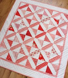 This quilt- as with many modern quilts- was inspired by an old-fashioned quilt block. Using solid white updated the look and off-set as well as unified the busy-ness of the prints. I love that even though the quilt is made with one simple block, the resulting design looks much more complex. This pattern is also pre-cut friendly, using 2 1/2 strips and 5 squares.