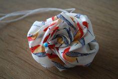 Bloem van stof II « Tantehilde.be Does that mean fabric flower?