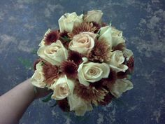 Fall color bouquet with light taupe roses and rust mums.