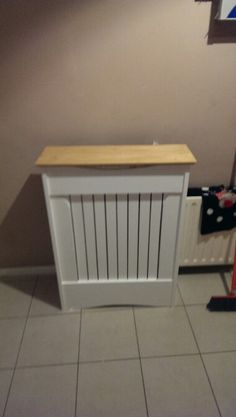 Small radiator cover. White with redwood top..