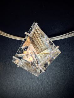 """Cradled in 14kt white gold and pavé diamonds, """"Glacier"""" is a rutilated quartz cut by Munsteiner to frame the drama within."""
