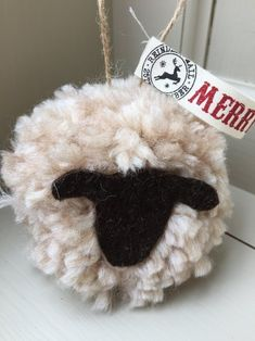 Giant sheep pom pom Christmas decorations: these large sheep hanging pom poms make a great hanging door decoration. Made from wooden yarn they are around the size of a tennis ball (or a little larger ...)