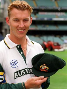 Brett Lee is presented with his baggy green cap before the Boxing Day Cricket Test between Australia and India at the MCG in Icc Cricket, Cricket Bat, Cricket Sport, Ab De Villiers Birthday, Brett Lee, Alpha Man, India Cricket Team, Kane Williamson, Cricket Wallpapers