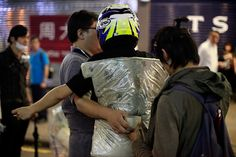 Umbrella Revolution Hong Kong, Young people wrap tape to secure a protective cushion on a protester at Nathan Road in Mongkok district on November 25, 2014 in Hong Kong, Hong Kong. The Mong Kok protest site is scheduled for clearance by bailiffs this week after Hong Kong's high court authorized police to arrest protesters who obstruct bailiffs on the three interim restraining orders. (Photo by On Man Kevin Lee/Getty Images)