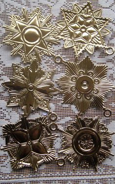 Die cut and embossed German foil stars and medallions for making Victorian Christmas ornaments