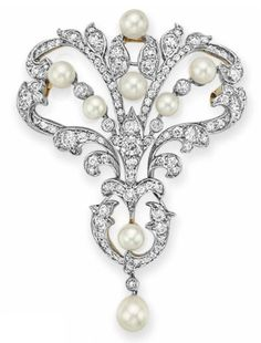 AN ANTIQUE PEARL AND DIAMOND BROOCH, BY TIFFANY & CO., Designed as an openwork plaque of foliate design, set with old European-cut diamonds and pearls, measuring from approximately 4.50 to 6.18 mm, mounted in platinum and gold, circa 1906, with pendant hook for suspension, in a Tiffany & Co. tan leather case, Signed Tiffany & Co.