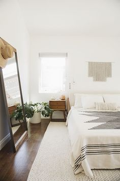 Neutrals with dark wood give this bedroom a feeling of space and warmth - works for us.