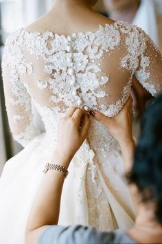 Beautiful lace wedding dress. I think the buttons are the best part:)
