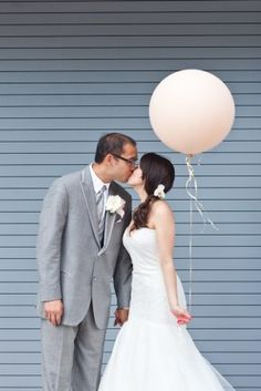 Bride and Groom with a Big Balloon at Le Meridien Arlington! Photograph by Tara Welch Photography.