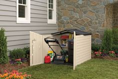 Rubbermaid Slide-Lid Plastic Storage Shed 96-cubic foot  - Shed is short enough to fit under standard fence heights yet has ample room to hold everything from long-handled tools to riding or push lawn mowers. Included Wall Anchors allow you to easily organize your belongings inside. Unique cane bolt locking mechanism secures doors and roof.
